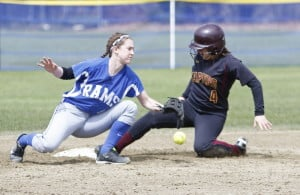 Michaela Pinette of Cape Elizabeth slides safely into second as Kennebunk's Malori Cole tries to field the throw. Pinette's two-run single in the third inning started the Capers' comeback after they fell behind 4-0.