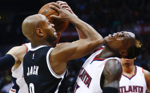 Brooklyn's Jarrett Jack, left, collides with Atlanta's Dennis Schroder during the second half of the Nets' 91-83 win Saturday in Atlanta.