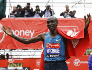 Eliud Kipchoge of Kenya celebrates after he wins the Men's race in the 35th London Marathon on Sunday.