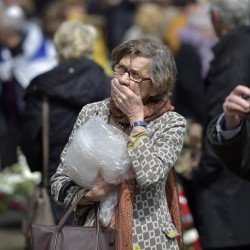 A elderly woman reacts at the mourning wall during a ceremony to mark the 70th anniversary of the liberation of the Bergen-Belsen concentration camp in Bergen, northern Germany, on Sunday.