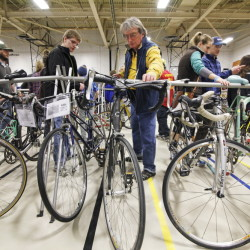 Buyers take a look at the merchandise during Sunday's Great Maine Bike Swap at USM's Sullivan Recreation and Fitness Center in Portland.