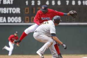 Sea Dogs shortstop Oscar Tejeda gets caught up with Trenton catcher Gary Sanchez at second base in the fourth inning at Hadlock Field in Portland on Sunday.