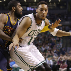 Kyrie Irving, left, of the Cavs puts pressure on Boston's Evan Turner in Sunday's playoff game at Boston.