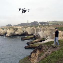 Romeo Durscher, director of education for drone-maker DJI, flies one of his company's products in Davenport , Calif.