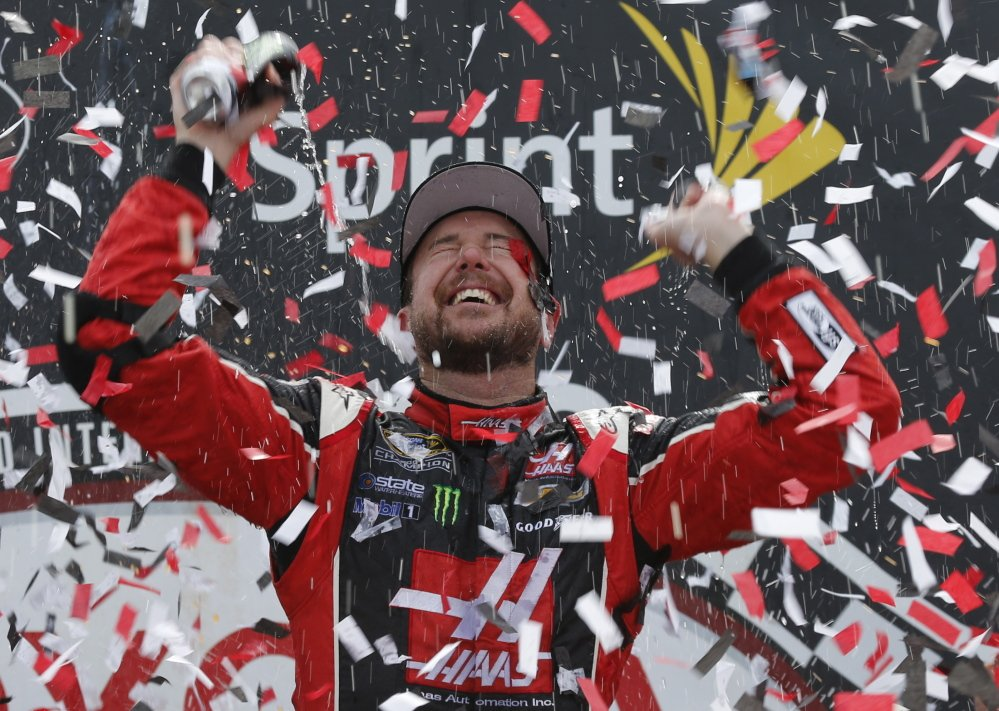 Kurt Busch celebrates after his victory Sunday in the Sprint Cup race at Richmond International Raceway.