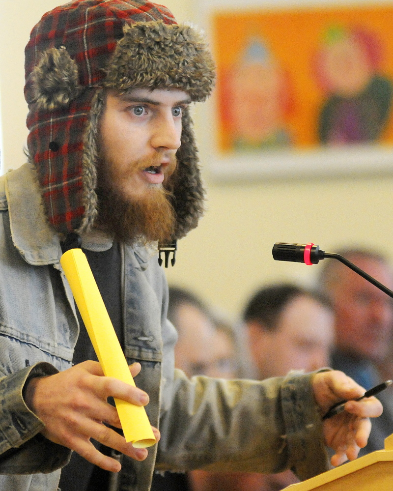 Dylan Medlin of Lebanon speaks Monday in favor of pending marijuana legislation during a hearing on several bills at the State House in Augusta.
