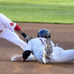 The Mets' Dustin Lawley slides safely into second on a steal as Sea Dog Carlos Asuaje makes the late tag Monday night. The game resumed Tuesday and the Mets won. The teams are playing a second, 7-inning game Tuesday night. (Photo by Gordon Chibroski/Staff Photographer)