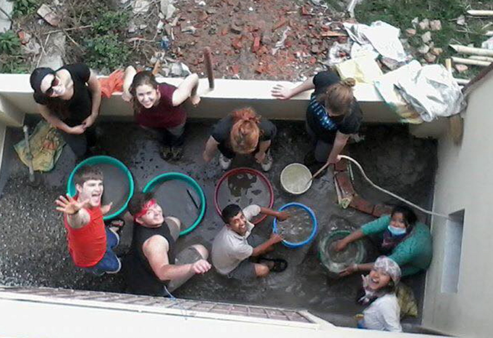 Ben Hichens of South Berwick, lower left, and other members of Biddeford-based 360 Maine build a water filtration system for residents of Bhaktapur, Nepal, on March 26.