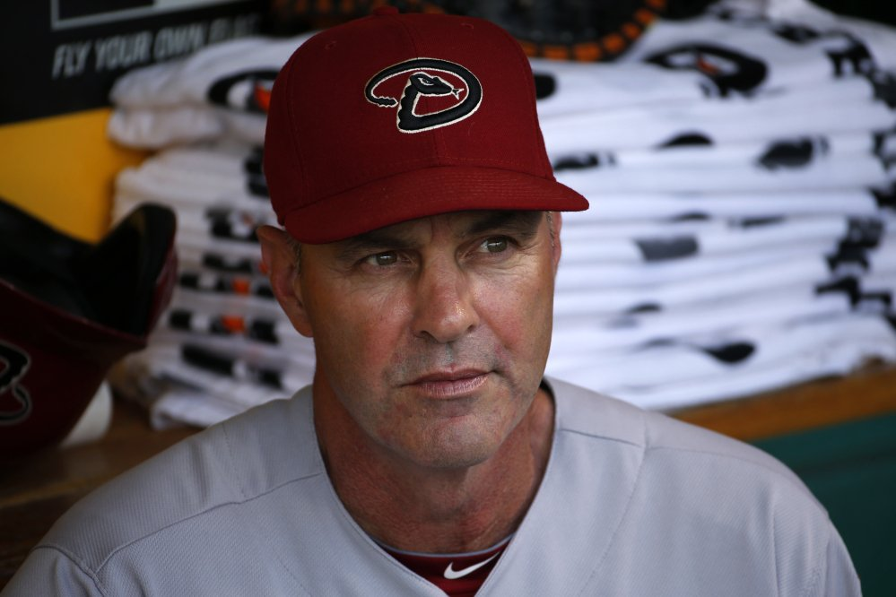 In this July 3, 2014, file photo, then-Arizona Diamondbacks manager Kirk Gibson sit in the dugout before a baseball game against the Pittsburgh Pirates in Pittsburgh.