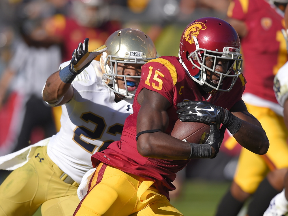 Southern California wide receiver Nelson Agholor, right, runs in for a touchdown as Notre Dame safety Elijah Shumate attempts to tackle him in an NCAA college football game in Los Angeles last year. (AP Photo/Mark J. Terrill)