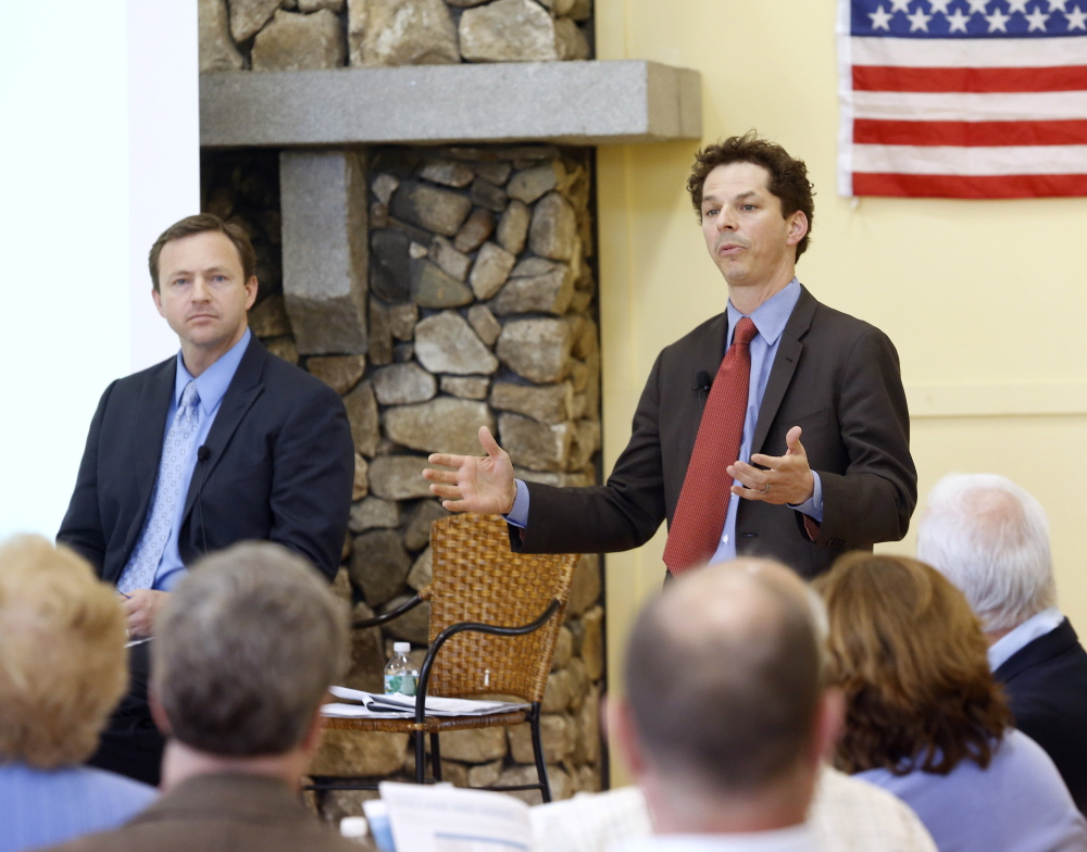 Sen. Justin Alfond, D-Portland, speaks as Democratic leaders hold a town hall meeting Tuesday night in Scarborough to discuss their plan to counter Gov. Paul LePage's proposed tax overhaul. House Speaker Mark Eves, D-North Berwick, left, listens as Alfond speaks.  Derek Davis/Staff Photographer