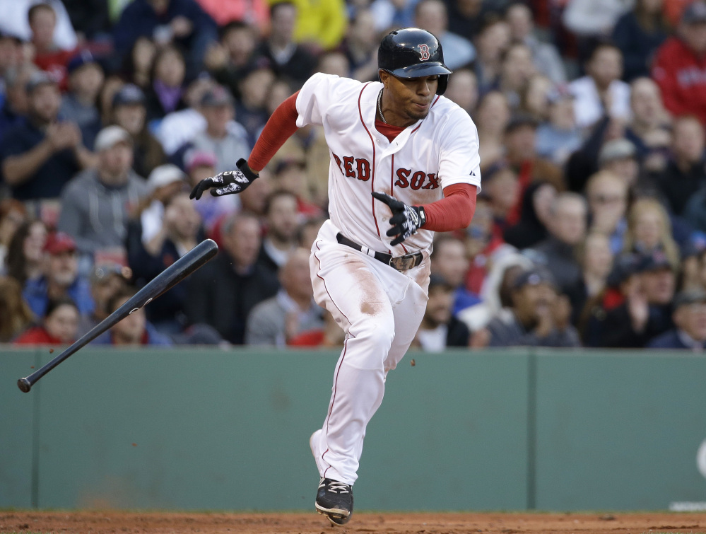 Xander Bogaerts runs to first after hitting an RBI single off a pitch by Toronto Blue Jays starting pitcher Drew Hutchison.