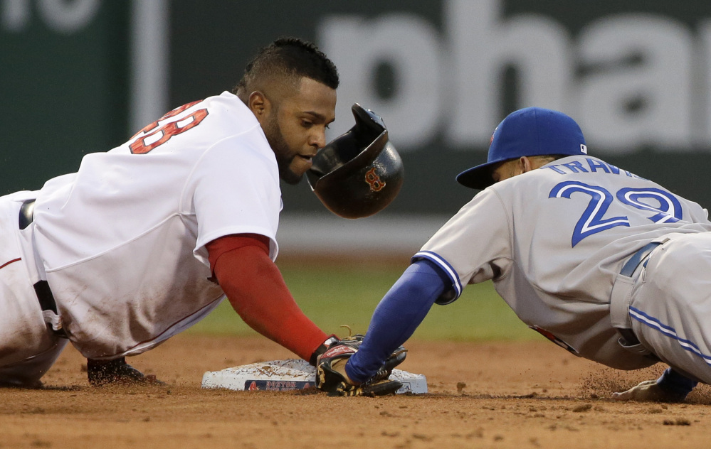 Boston's Pablo Sandoval loses his helmet as he arrives safely at second base as Toronto's Devon Travis tries to make the tag. (AP Photo/Steven Senne)