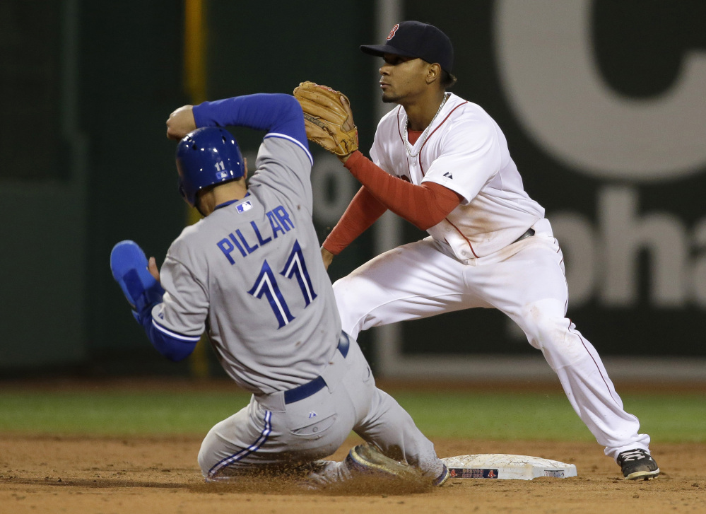 Toronto Blue Jays' Kevin Pillar steals second base as Boston Red Sox shortstop Xander Bogaerts waits for the ball in the fifth inning of Tuesday's game, in Boston. Pillar went on to score. (AP Photo/Steven Senne)