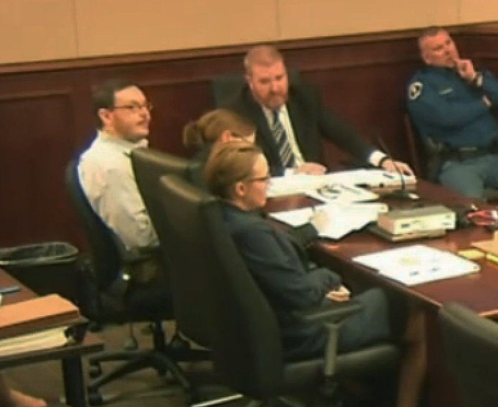 Colorado theater shooter James Holmes, far left, sits at the defense table at the opening of his trial in Centennial, Colo., Monday. The trial will determine if he'll be executed, spend his life in prison, or be committed to an institution as criminally insane.