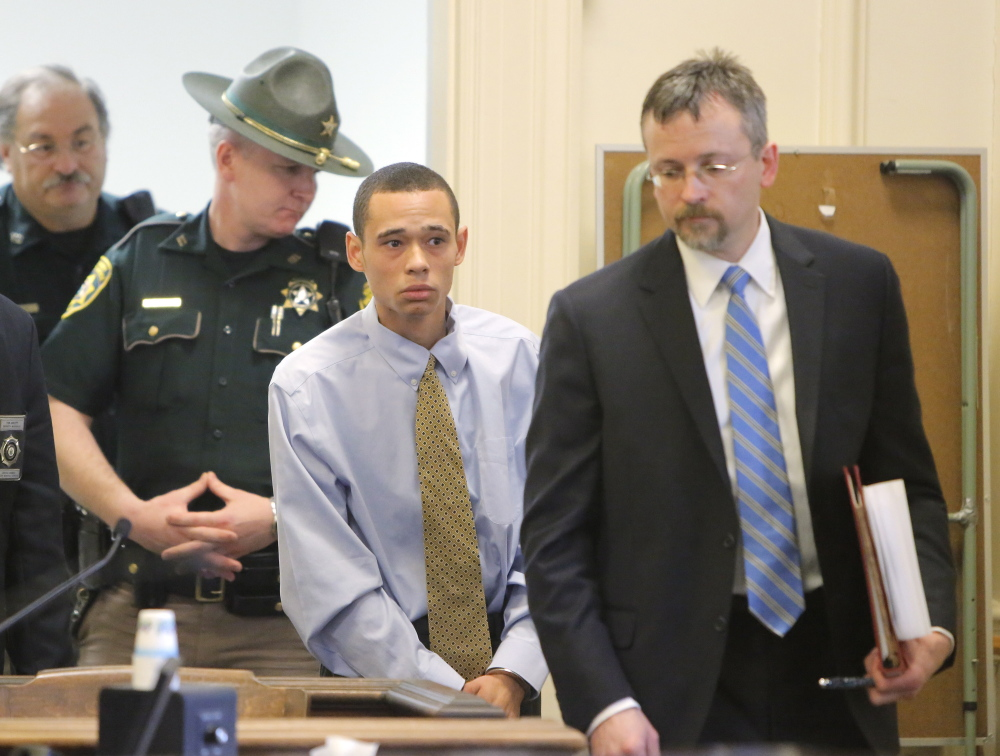 John Lopez, 20, of Old Orchard Beach, enters into York County Superior Court in Alfred on Wednesday with his appointed attorney Robert Ruffner, right, for his initial appearance after being charged with the murder of Charles Raybine in a Biddeford parking lot in 2013. Gregory Rec/Staff Photographer