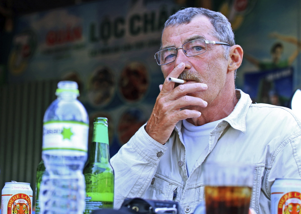 "Richard Parker, a Vietnam war veteran, relaxes in Danang, Vietnam. ""We were the bad guys,"" he said of the American war effort in Vietnam."