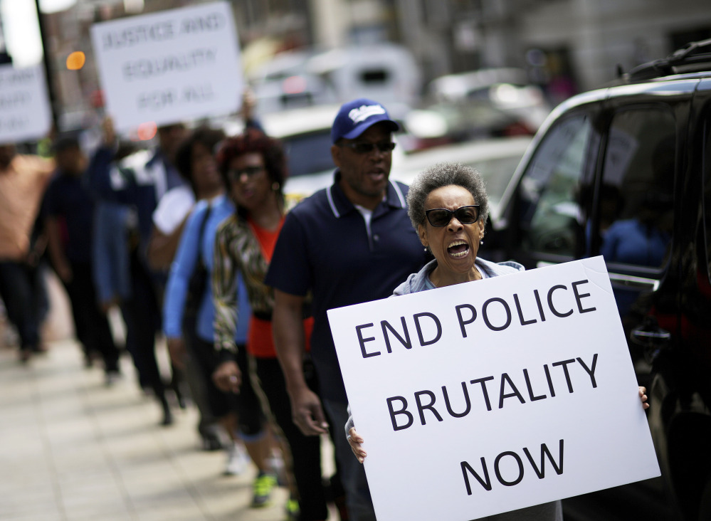 Protesters demonstrate outside the state attorney's office Wednesday calling for the continued investigation into the death of Freddie Gray. Activists stressed that they will continue to press for answers in the case.