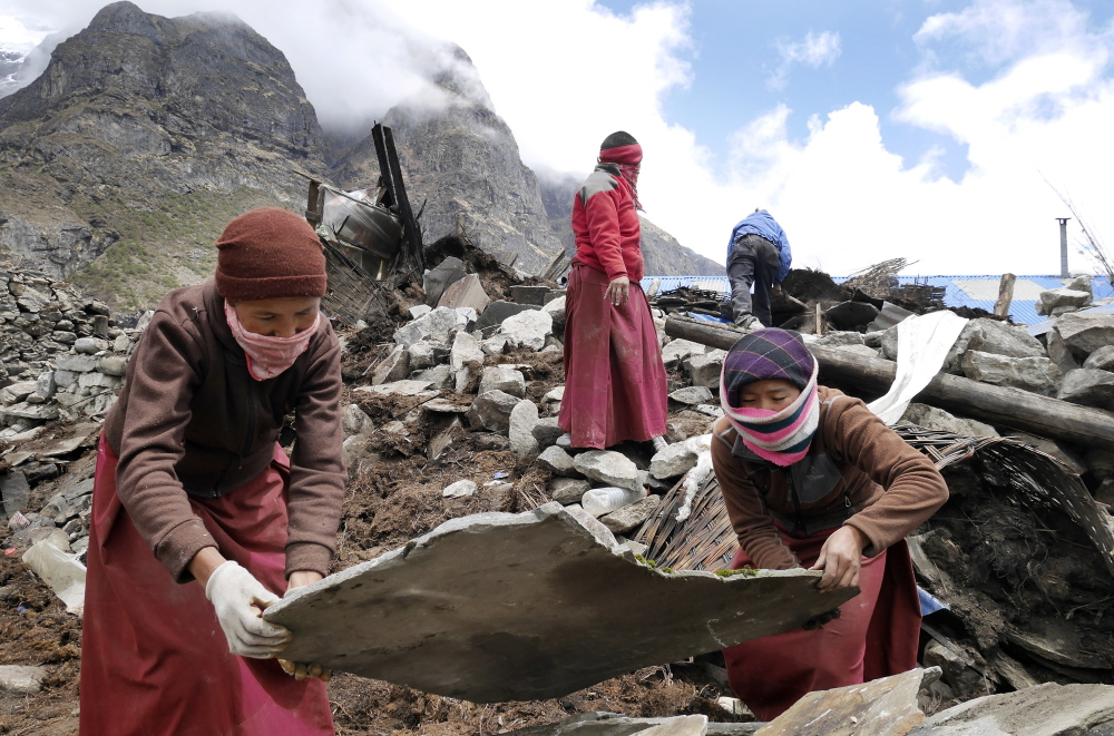 "Nuns from a monastery in the decimated village of Thame assist in the recovery effort Wednesday. ""Life in these villages is hard, harsh and often deadly,"" said Portland's Doug Bruns."