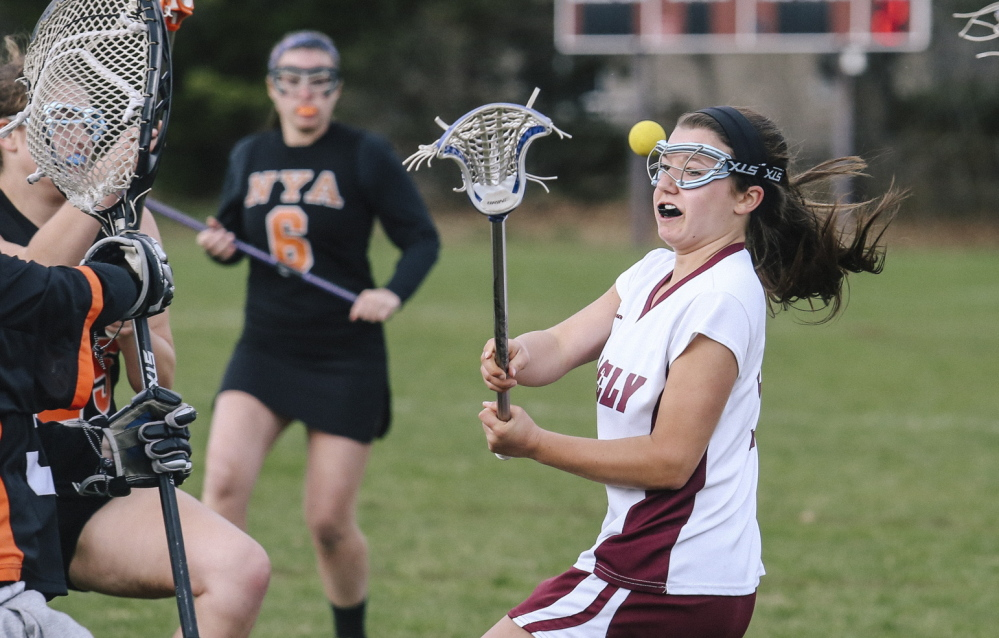 Ellie Schad, who scored two goals Wednesday for Greely, takes on the North Yarmouth Academy defense during their girls' lacrosse game. Greely came away with a 12-7 victory at Cumberland.