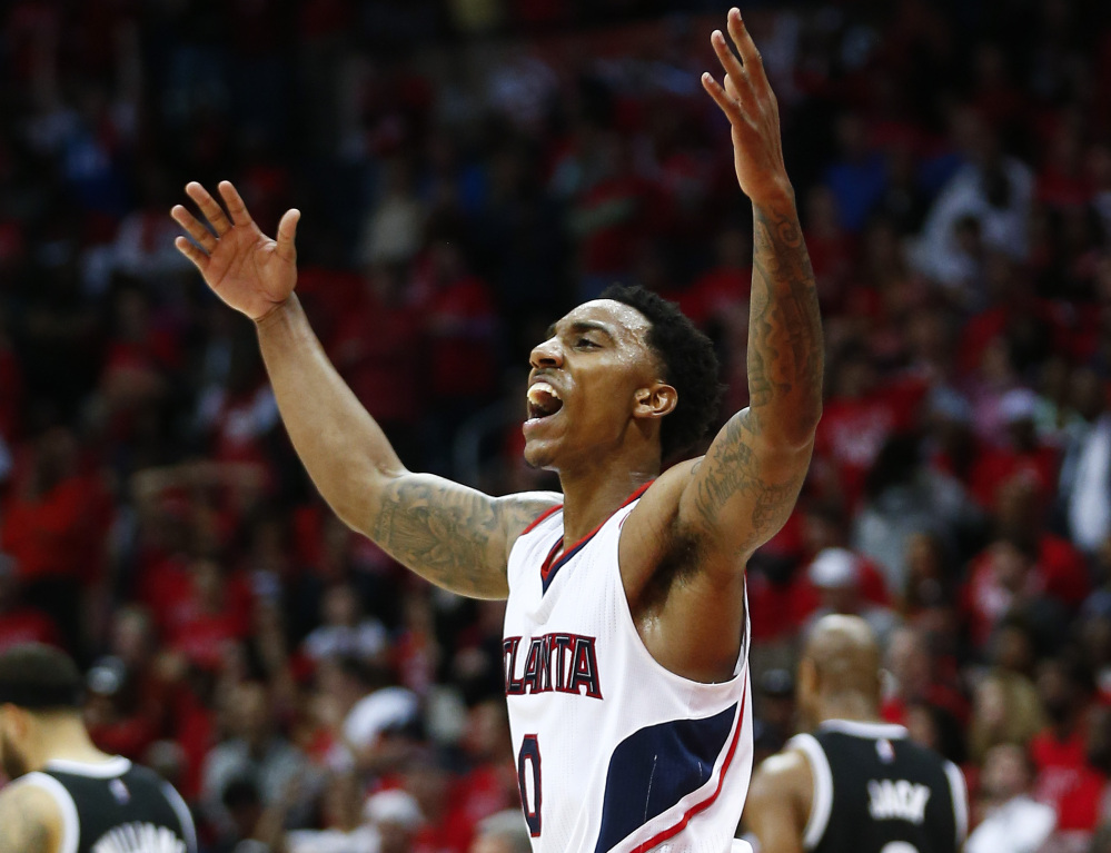 Jeff Teague of the Atlanta Hawks celebrates Wednesday night after a 107-97 victory against the Brooklyn Nets that gave Atlanta a 3-2 lead in their first-round series.