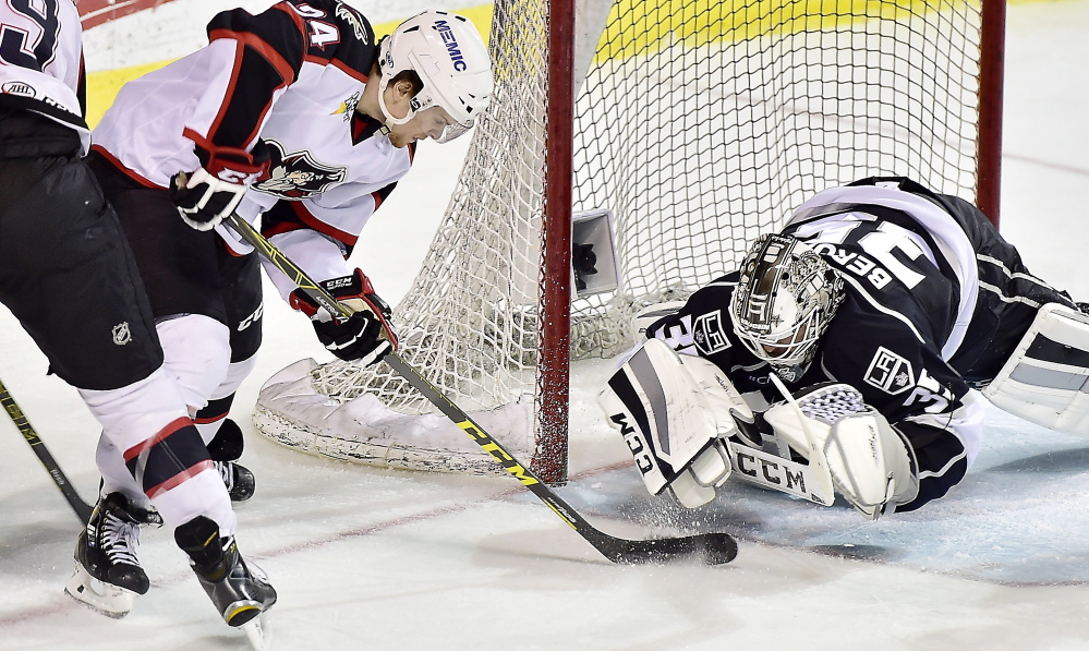 Pirate Brendan Shinnimin tries several times to put the puck in the goal but is stopped by Monarchs goalie Jean-Francois Berube in Game 4 of their AHL playoff series Thursday. The Pirates shut out the Monarchs at the Cross Insurance Arena.