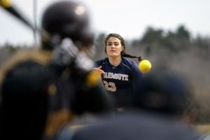 Yarmouth's Cat Thompson delivers a pitch to a Cape batter in the opening softball game on April 16 at Cape Elizabeth.