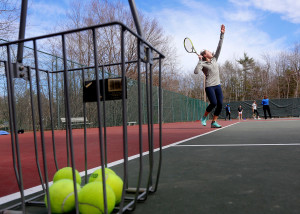Sophomore Caroline Ray works on her serve while practicing with the Falmouth High tennis team. Falmouth enters the 2015 season with a 109-match winning streak.