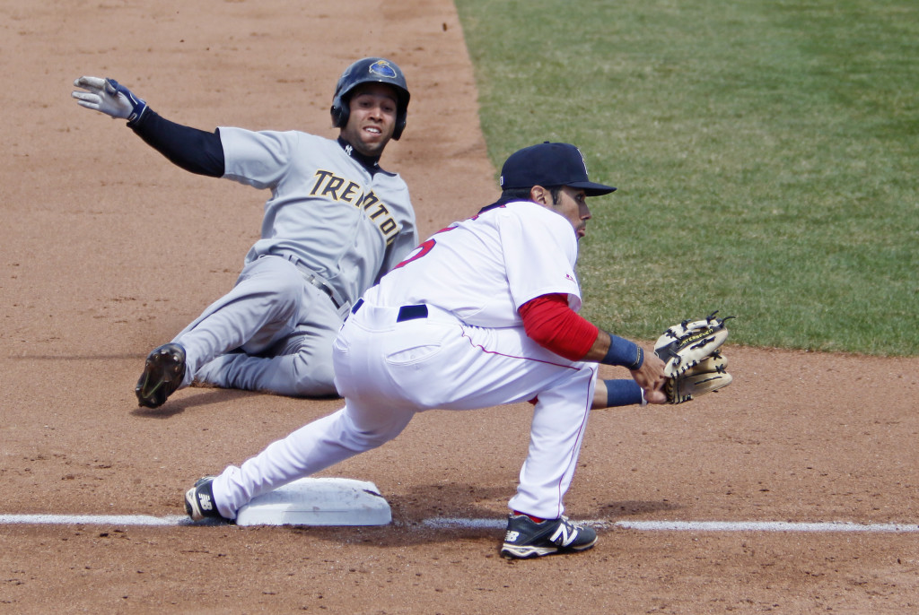Portland's Carlos Asuaje waits for the throw from home while Trento's Cito Culver safely steals third base in the fifth inning at Hadlock Field on Saturday. Jill Brady/Staff Photographer