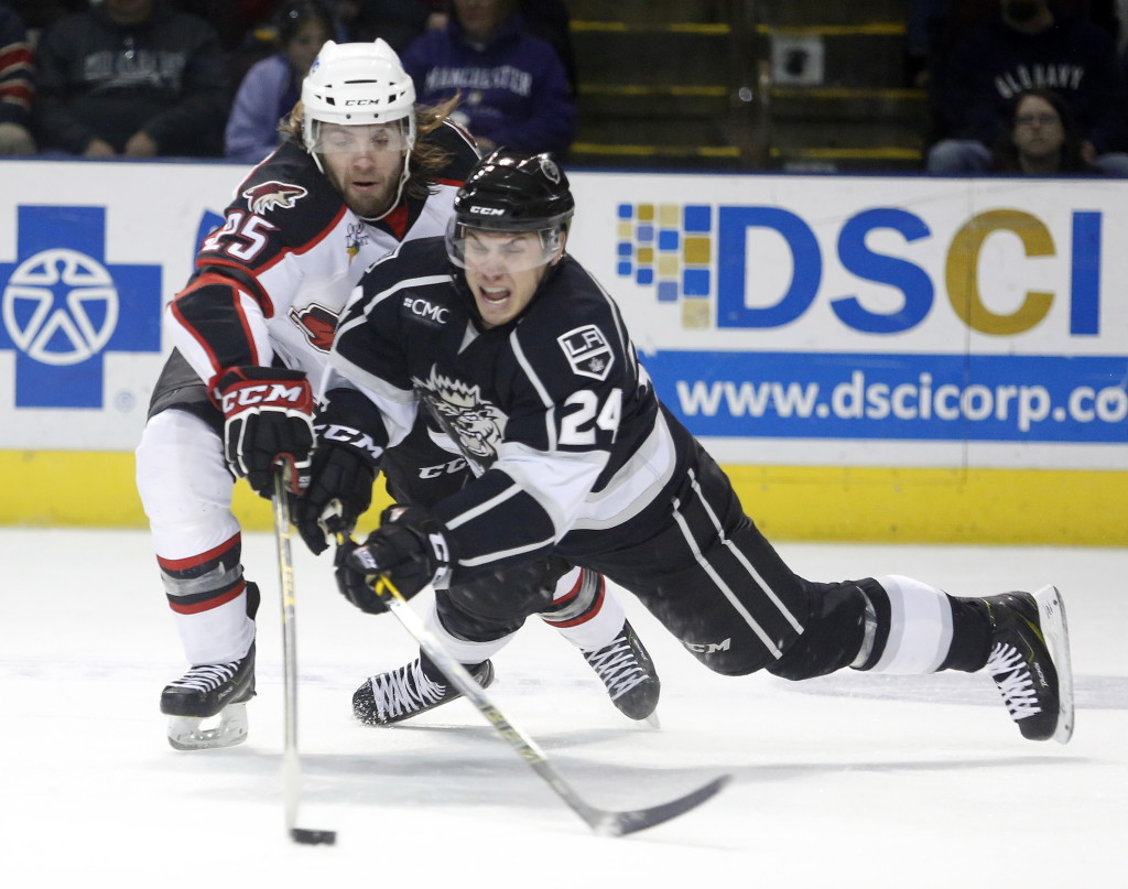 Eric Selleck of the Portland Pirates reaches to knock the puck awayfrom Ryan Horvat of the Manchester Monarchs in the second period Sunday at Cross Insurance Arena in Portland. The Pirates won 3-2. Game 4 of their first-round series will be played Thursday in Portland. Derek Davis/Staff Photographer