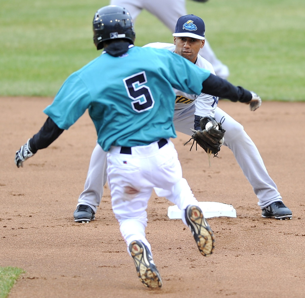 Sea Dogs second baseman Carlos Asuaje attempts a steal against the Trenton Thunder at Hadlock Field on Thursday. Gordon Chibroski/ Staff Photographer