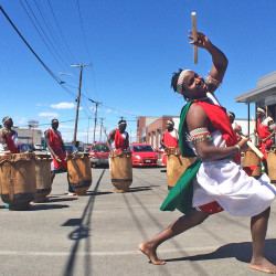 A member of a Burundian drumming group performs outside Coffee by Design in Portland on Tuesday. The group performed prior to a news conference welcoming Isabelle Sinamenye, president of the Burundi chapter of the International Women's Coffee Alliance. Coffee by Design buys coffee from the chapter.