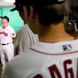 Robby Scott, a pitcher for the Portland Sea Dogs, eyes a boom microphone placed in front of him during media day at Hadlock Field on Wednesday. At right are teammates Reed Gragnani and Jantzen Witte.