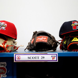 Hats and gloves are ready to go atop the locker of left-handed pitcher Robby Scott at Hadlock Field.
