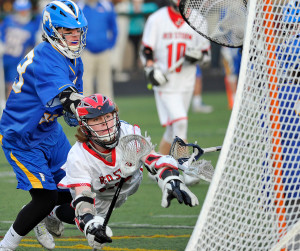 Scarborough'sSam Neugbauer dives as he launches a shot into the goal against Falmouth. He was called for being in the crease and the goal did not count in the Red Storm's 11-10 boys' lacrosse loss to Falmouth.