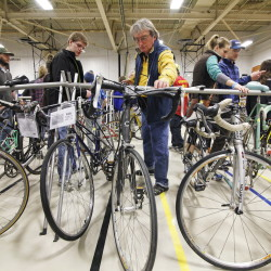 Potential buys inspect bikes at Sunday's Great Maine Bike Swap at USM in Portland. Jill Brady/Staff Photographer