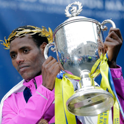 Lelisa Desisa lifts his trophy after winning the Boston Marathon.
