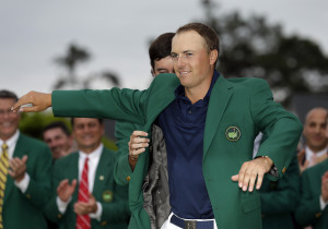 Bubba Watson helps Jordan Spieth put on his green jacket after winning the Masters. The Associated Press