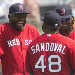 David Ortiz, left, Pablo Sandoval and Hanley Ramirez chat during a spring training game  in Fort Myers, Fla., In this March 3, 2015, photo. The Associated Press