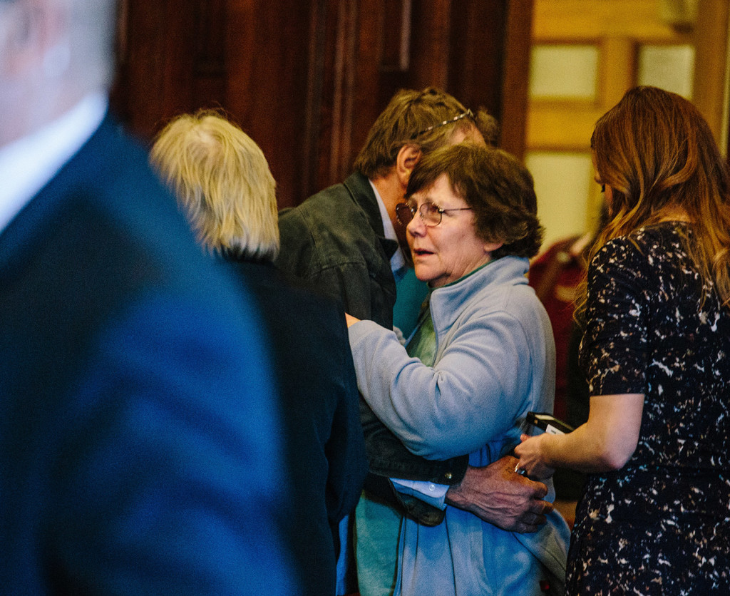 """Kathleen Kelley, wife of Leon Kelley, and William Kelley, brother of the victim, hug after Merrill """"Mike"""" Kimball is found guilty of Leon Kelley's murder on April 15. Kathleen Kelley is seeking $1 million from Kimball in a wrongful-death lawsuit."""