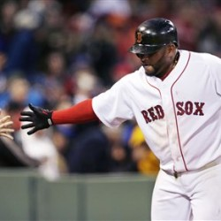 Boston Red Sox's Pablo Sandoval is congratulated by fans after his solo home run against the Toronto Blue Jays in the fourth inning at Fenway Park Monday. (AP Photo/Charles Krupa)