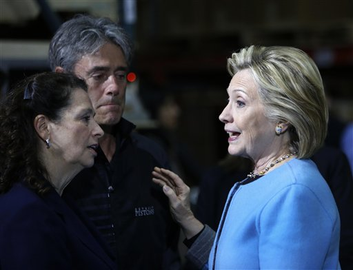 Democratic presidential candidate Hillary Rodham Clinton meets with employees at Whitney Brothers during a campaign stop in Keene, N.H., on Monday. The Associated Press