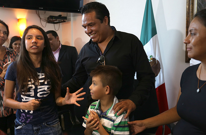 Alondra Luna Nunez, left,  with her parents Gustavo Luna and Susana Nunez  in Silao, Mexico.