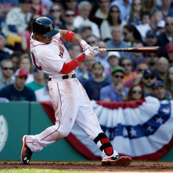 Boston Red Sox's Mookie Betts hits a three-run home run in the second inning of Monday's game in Boston.