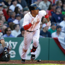 Boston Red Sox's Mookie Betts runs toward first base after hitting a three-run home run in the second inning of Monday's home opener at Fenway Park.