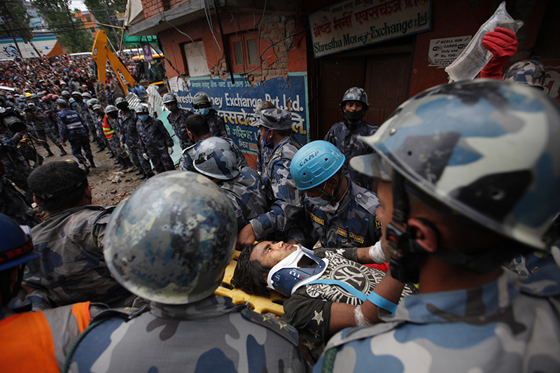 Crowds cheered Thursday as teenager Pemba Tamang was pulled, dazed and dusty, from the wreckage of a seven-story Kathmandu building that collapsed around him five days ago.