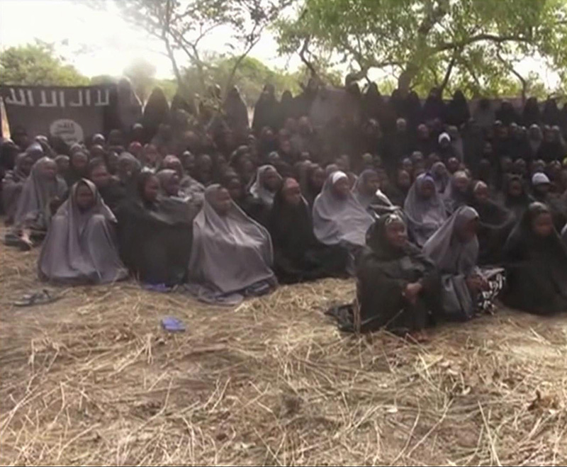 Image taken from a 2014 video by Nigeria's Boko Haram terrorist network, shows the alleged missing girls abducted from the northeastern town of Chibok.