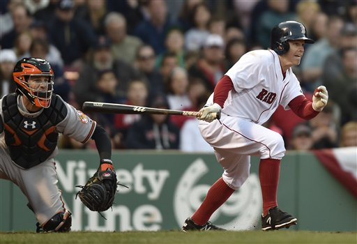 Red Sox center fielder Brock Holt hits an infield single in the seventh inning against the Orioles on Saturday. The Associated Press
