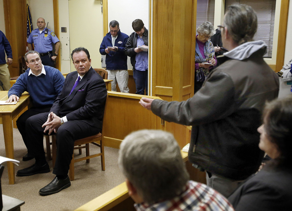 Dean Smart, brother of Gregory Smart, speaks to Patrick Randall, left, with his attorney Mark Stevens during Randall's parole hearing Thursday. The Associated Press