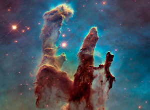"""The iconic Eagle Nebula's """"Pillars of Creation"""" is seen in this NASA image released Jan. 6, 2015. By comparing 1995 and 2014 pictures, astronomers noticed a lengthening of a narrow jet-like feature that may have been ejected from a newly forming star. Over the intervening 19 years, this jet has stretched farther into space, across an additional 60 billion miles, at an estimated speed of about 450,000 miles per hour, according to a NASA news release."""